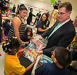 Houston ISD Superintendent Dr. Terry Grier hands out school supplies on the first day of classes at Marshall Elementary School, August 26, 2013.