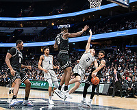 WASHINGTON, DC - FEBRUARY 19: Alpha Diallo #11 of Providence crashes into Mac McClung #2 of Georgetown during a game between Providence and Georgetown at Capital One Arena on February 19, 2020 in Washington, DC.