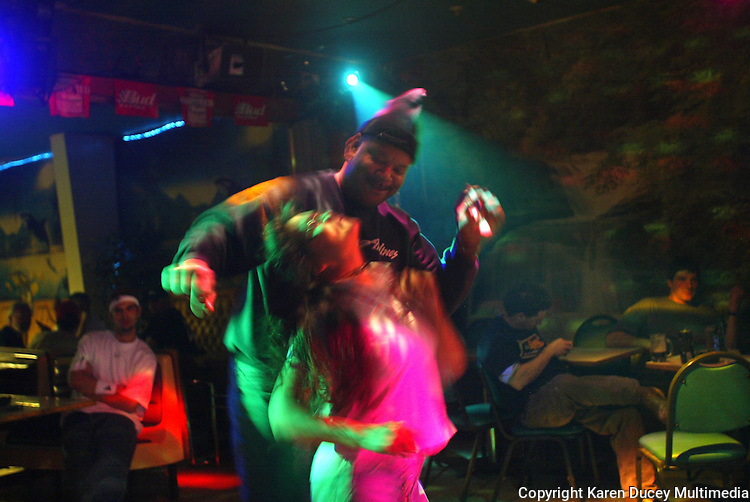 10/23/03 crab NWS::  Ralph Harvey, a cargo agent for Penn Air Alaska Airlines, dances with Barbara Miles at Carls, a bar in Unalaska, AK.