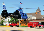CareFlight lands at the American Legion LZ on Monday afternoon to transport the victim of a lawn mower vs. car crash that occurred on Sunset Drive.