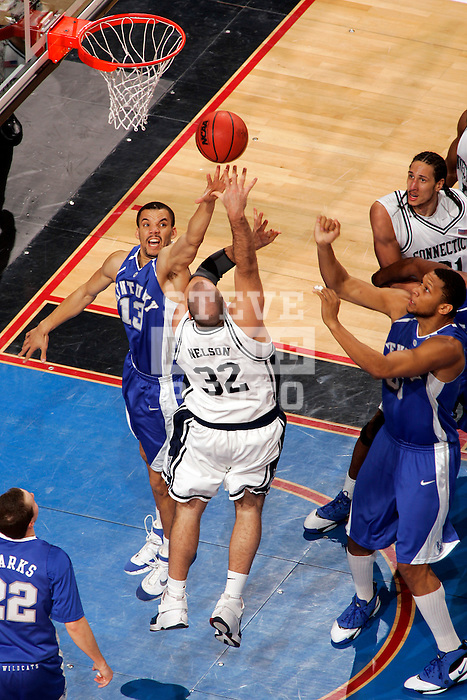 Connecticut forward Ed Nelson (32) shoots over Kentucky forward Bobby Perry (13).  Connecticut defeated Kentucky 87-83 in the second round of the NCAA Tournament  at the Wachovia Center in Philadelphia, Pennsylvania on March 19, 2006.