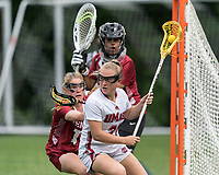 NEWTON, MA - MAY 14: Julia Smith #22 of University of Massachusetts looks to pass as Katie Shallow #13 of Temple University defends during NCAA Division I Women's Lacrosse Tournament first round game between University of Massachusetts and Temple University at Newton Campus Lacrosse Field on May 14, 2021 in Newton, Massachusetts.