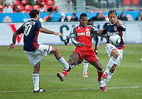 02 April 2011: Chivas USA midfielder Gerson Mayen #14 and Chivas midfielder Nick LaBrocca #10 battles with Toronto FC midfielder Julian de Guzman #6 during an MLS game between Chivas USA and the Toronto FC at BMO Field in Toronto, Ontario Canada..The game ended in a 1-1 draw.