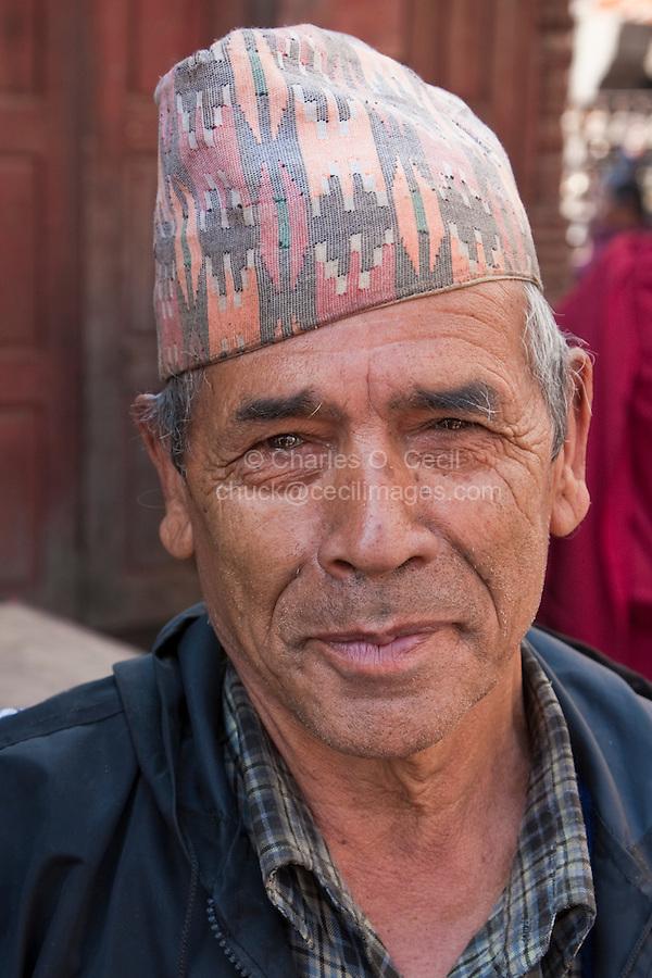 Kathmandu, Nepal.  A Nepali Man Wearing a Topi, a Traditional Nepali Hat.
