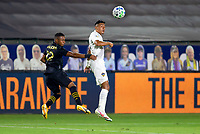 CARSON, CA - SEPTEMBER 06: Julian Araujo #22 of Los Angeles Galaxy heads a ball during a game between Los Angeles FC and Los Angeles Galaxy at Dignity Health Sports Park on September 06, 2020 in Carson, California.