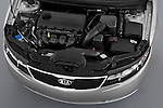 High angle engine detail of a 2010 Kia Forte EX .