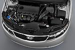 High angle engine detail of a 2010 Kia Forte EX .