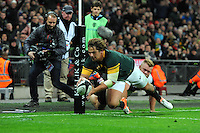 Ruan Janse van Rensburg of South Africa scores a try in the corner during the Killik Cup match between Barbarians and South Africa at Wembley Stadium on Saturday 5th November 2016 (Photo by Rob Munro)