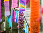 Colorful yarn wrapping of walkway bridge.