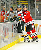 18 January 2008: Northeastern University Huskies' defenseman Drew Muench (21), a Freshman from Martensville, Saskatchewan, checks University of Vermont Catamounts' forward Colin Vock, a Sophomore from Plymouth, MI, during game action at Gutterson Fieldhouse in Burlington, Vermont. The two teams battled to a 2-2 tie in the first game of their 2-game weekend series...Mandatory Photo Credit: Ed Wolfstein Photo
