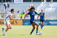 CARY, NC - SEPTEMBER 12: Emily Menges #5 of the Portland Thorns gives chase as Jessica McDonald #14 of the NC Courage dribbles the ball during a game between Portland Thorns FC and North Carolina Courage at Sahlen's Stadium at WakeMed Soccer Park on September 12, 2021 in Cary, North Carolina.