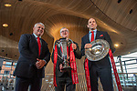 Wales's national rugby team who won both the Six Nations and the Grand Slam are welcomed to the National Assembly for Wales Senedd building in Cardiff Bay today for a public celebration event.<br />Coach Warren Gatland and Captain Alun Wyn Jones are pictured inside the Senedd building with the First Minister for Wales Mark Drakeford