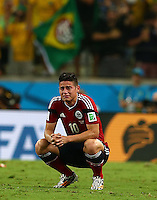James Rodriguez of Colombia in tears at full time after being eliminated from the World Cup following a 2-1 defeat to Brazil