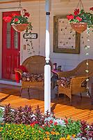 Annual garden of mixed flowers marigolds, Dusty miller, bidens, zinnias, celosia, dahlia, house porch for sense of sunny style