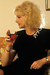 Mandy Rice Davies portrait in her London home 1990s UK