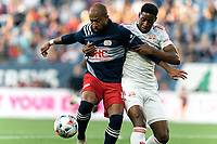 FOXBOROUGH, MA - JUNE 23: Teal Bunbury #10 of New England Revolution battles for the ball during a game between New York Red Bulls and New England Revolution at Gillette Stadium on June 23, 2021 in Foxborough, Massachusetts.