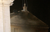 Fumo nero esce dal comignolo sul tetto della Cappella Sistina, Citta' del Vaticano, 12 marzo 2013. La fumata nera indica che il nuovo Papa della Chiesa Cattolica Romana non e' stato ancora eletto dai 115 cardinali del Conclave..Black smoke billows from the chimney atop the Sistine Chapel where 115 cardinals gathered to elect the new Pope of the Roman Catholic Church, at the Vatican, 12 March 2013. The black smoke indicates that the cardinals in the Conclave have not elected the new Pontiff..UPDATE IMAGES PRESS/Isabella Bonotto STRICTLY FOR EDITORIAL USE ONLY - STRICTLY FOR EDITORIAL USE ONLY