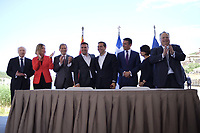 Pictured: Matthew Nimetz of the United Nations, Federica Maria Mogherini, Unknown, Zoran Zaevat, Prime Minister for FYROM, Greek Prime Minister Alexis Tsipras Nikola Dimitrov Minister of Foreign Affairs of FYROM and Greek foreign minister Nikos Kotzias at Prespa Lake in northern Greece. Sunday 17 June 2018<br /> Re: Greece and the Former Yugoslav Republic Of Macedonia (FYROM) have signed a deal that aims to settle a decades-long dispute over the country's name.<br /> Under the agreement, Greece's neighbour will be known as North Macedonia.<br /> Heated rows over Macedonia's name have been going on since the break-up of the former Yugoslavia, of which it was a part, and have held up Macedonia's entry to Nato and the EU.<br /> Greece has long argued that by using the name Macedonia, its neighbour was implying it had a claim on the northern Greek province also called Macedonia.<br /> The two countries' leaders, Mr Tsipras and his Macedonian counterpart Zoran Zaev announced the deal on Tuesday and have pressed ahead despite protests.<br /> The two countries' foreign ministers signed the deal on Lake Prespa on Greece's northern border on Sunday.<br /> The agreement still needs to be approved by both parliaments and by a referendum in Macedonia.
