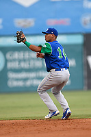 Second baseman Carlos Diaz (14) of the Lexington Legends fields a ground ball during a game against the Greenville Drive on Sunday, September 2, 2018, at Fluor Field at the West End in Greenville, South Carolina. Greenville won, 7-4. (Tom Priddy/Four Seam Images)