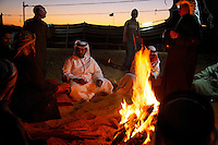 Traditional emblems of Bedouin culture--tents, a well-tended fire--mingle with symbols of modernity--packs of cigarettes and mobile phones.
