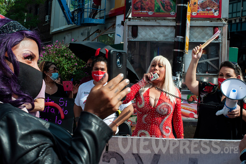 NEW YORK, QUEENS - NY SEPTEMBER 18: Community leader Laura Martinez chants slogans on a megaphone during a demonstration against discrimination against sex workers held on 18 September, 2020 in Jackson Heights,Queens,New York.  (Photo by Joana Toro /VIEWpress)