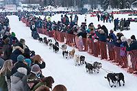Sonny Lindner team leaves the start line during the restart day of Iditarod 2009 in Willow, Alaska