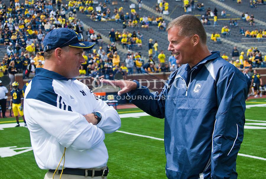 Michigan head coach Rich Rodriguez, left, talks with Connecticut head coach Randy Edsall before an NCAA college football game, Saturday, Sept. 4, 2010, in Ann Arbor, Mich. (AP Photo/Tony Ding)