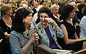 Luci Baines Johnson and Lynda Bird Johnson Robb, daughters of President Lyndon Johnson wipe tears at former US Rep. Lindy Boggs'  funeral at St. Louis Cathedral, New Orleans, Aug. 1, 2013.