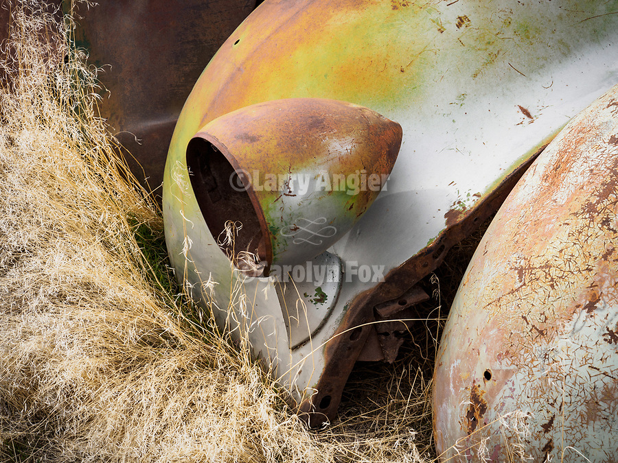 Headlight in a yard full of auto and truck parts, grills, headlights, Golconda, Nev.