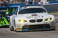 The #90 BMW of Dirk Muller, Joey Hand and Andy Priauix leads another car during the 12 Hours of Sebring, Sebring, FL, MArch 20, 2010.  (Photo by Brian Cleary/www.bcpix.com)
