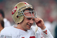 NEW ORLEANS, LA - Quarterback Joe Montana of the San Francisco 49ers smiles on the sidelines during Super Bowl XXIV against the Denver Broncos at the Superdome in New Orleans, Louisiana on January 28, 1990. Photo by Brad Mangin.