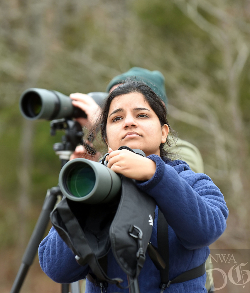 NWA Democrat-Gazette/FLIP PUTTHOFF<br />Pooja Panwar of Fayetteville sees loons through her spotting scope during a visit Jan. 26 2018 to Lake Tenkiller in northeast Oklahoma. The big reservoir attracts flocks of loons and other waterfowl that can be seen during winter and early spring.