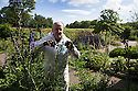 07/07/15<br /> <br /> Head Gardener, Trevor Jones, inspects deadly Monkshood/Aconitum surrounded by other blooming poisonous plants.<br /> <br /> The Poison Garden, Alnwick Garden.<br /> <br /> All Rights Reserved: F Stop Press Ltd. +44(0)1335 418629   www.fstoppress.com.
