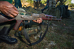 Anti-poaching scout checking rifle before deployment, Kafue National Park, Zambia