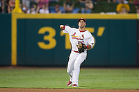 Luis Mateo (26) of the Springfield Cardinals throws to first base during a game against the Northwest Arkansas Naturals at Hammons Field on August 23, 2013 in Springfield, Missouri. (David Welker/Four Seam Images)