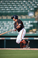 GCL Orioles right fielder Juan Montes (9) hits a single during the first game of a doubleheader against the GCL Twins on August 1, 2018 at CenturyLink Sports Complex Fields in Fort Myers, Florida.  GCL Twins defeated GCL Orioles 7-6 in the completion of a suspended game originally started on July 31st, 2018.  (Mike Janes/Four Seam Images)