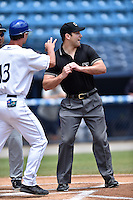 Frst base umpire Jason Johnson ejects Asheville Tourists manager Warren Schaeffer (13) before a game against the Charleston RiverDogs at McCormick Field on July 10, 2016 in Asheville, North Carolina. The Tourists defeated the RiverDogs 4-2. (Tony Farlow/Four Seam Images)