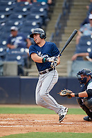 Lakeland Flying Tigers designated hitter Dylan Burdeaux (34) follows through on a swing in front of catcher Keith Skinner (10) during a game against the Tampa Tarpons on April 8, 2018 at George M. Steinbrenner Field in Tampa, Florida.  Lakeland defeated Tampa 3-1.  (Mike Janes/Four Seam Images)