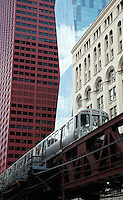 01 JUL 2014 - CHICAGO, USA - One of the trains of Chicago's elevated train system, the L, passes buildings on South Wabash Avenue in Chicago in the USA (PHOTO COPYRIGHT © 2014 NIGEL FARROW, ALL RIGHTS RESERVED)