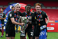 Ryan Watson, James Olayinka (on loan from Arsenal) and Callum Morton (on loan from WBA) of Northampton Town  celebrate promotion to League One with the trophy after a 4-0 victory in the Sky Bet League 2 PLAY-OFF Final match between Exeter City and Northampton Town at Wembley Stadium, London, England on 29 June 2020. Photo by Andy Rowland.