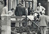 1978<br />  FILE PHOTO - ARCHIVES -<br /> <br /> Police remove body, of 16-year-old Paul Reid from Albany Ave. house where he held a 15-year-old girl hostage for nearly 7 hours before being shot to death by Police Supt. Frank Barbetta. We felt sure he meant to kill her. And we felt we had to take action to prevent it. We waited for an opportunity, Barbetta said. He fired two shots at knife-wielding boy. One bullet struck him in heart, the other hit a wall. Reid is third person shot to death by Metro police this month.<br /> <br /> Bezant, Graham<br /> Picture, 1978<br /> <br /> 1978<br /> <br /> PHOTO : Graham Bezant - Toronto Star Archives - AQP