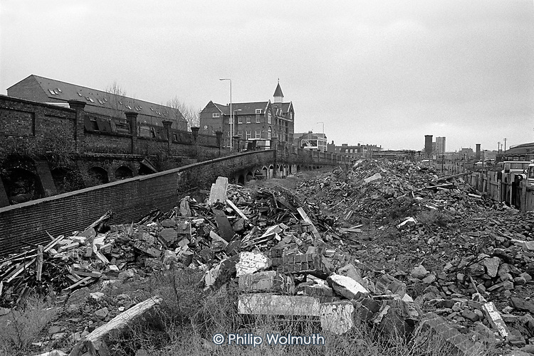 Piles of rubble on the Railway Lands development site, King's Cross, London 1990.