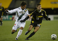 Los Angeles Galaxy's Paulo Nagamura (left) and Columbus Crew's Kyle Martino (10) during the second half at Columbus Crew Stadium in Columbus, Ohio Saturday April 2, 2005.