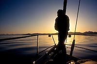 A sailor looks out over the serene waters of Frederick Sound near the southern end of Admiralty Island in southeast Alaska. M