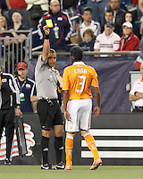 Referee issues yellow card warning to Houston Dynamo midfielder Calen Carr (3). In a Major League Soccer (MLS) match, the New England Revolution tied Houston Dynamo, 2-2, at Gillette Stadium on May 19, 2012.
