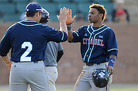 Second baseman Mason Davis (20), right, of the Citadel is congratulated after scoring a run in a game against the University of South Carolina Upstate Spartans on Tuesday, February, 18, 2014, at Cleveland S. Harley Park in Spartanburg, South Carolina. Upstate won, 6-2. (Tom Priddy/Four Seam Images)