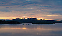 28/06/16<br /> <br /> Dawn breaks over Carsington Water, near Ashbourne, Derbyshire.<br /> <br /> Planning for the reservoir started in the 1960s with actual construction starting in 1979. In 1984 there was a partial collapse of the dam prior to its filling. The dam was subsequently completely removed before construction of a new dam commenced in 1989. The finished reservoir  opened in 1992.<br /> <br /> All Rights Reserved, F Stop Press Ltd. +44 (0)1773 550665