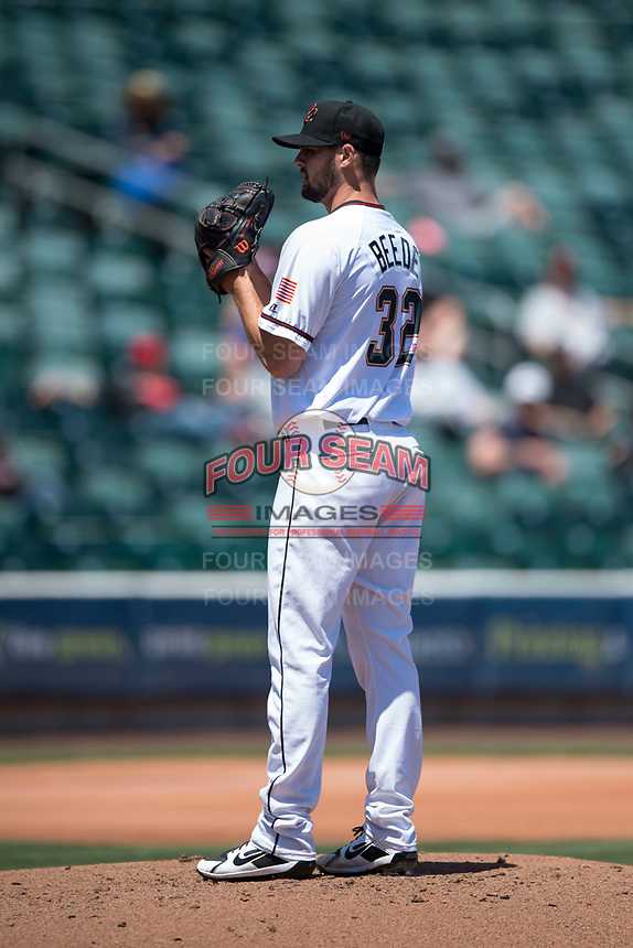 Sacramento RiverCats starting pitcher Tyler Beede (32) looks to his catcher for the sign during a Pacific Coast League against the Tacoma Rainiers at Raley Field on May 15, 2018 in Sacramento, California. Tacoma defeated Sacramento 8-5. (Zachary Lucy/Four Seam Images)