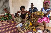 Senegal, Touba.  Senegalese Enjoying the Shade of a Tree.