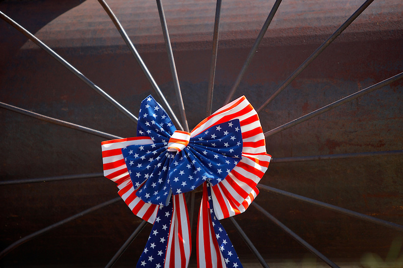 US flag ribbon on spokes of wheel. Oregon